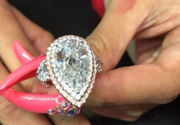 10 Celebrity Halo Engagement Rings We Love