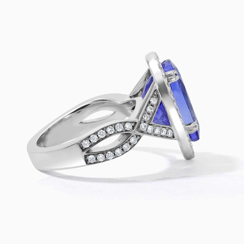 18ct White Gold Pear Shape Tanzanite and Diamond Halo Ring