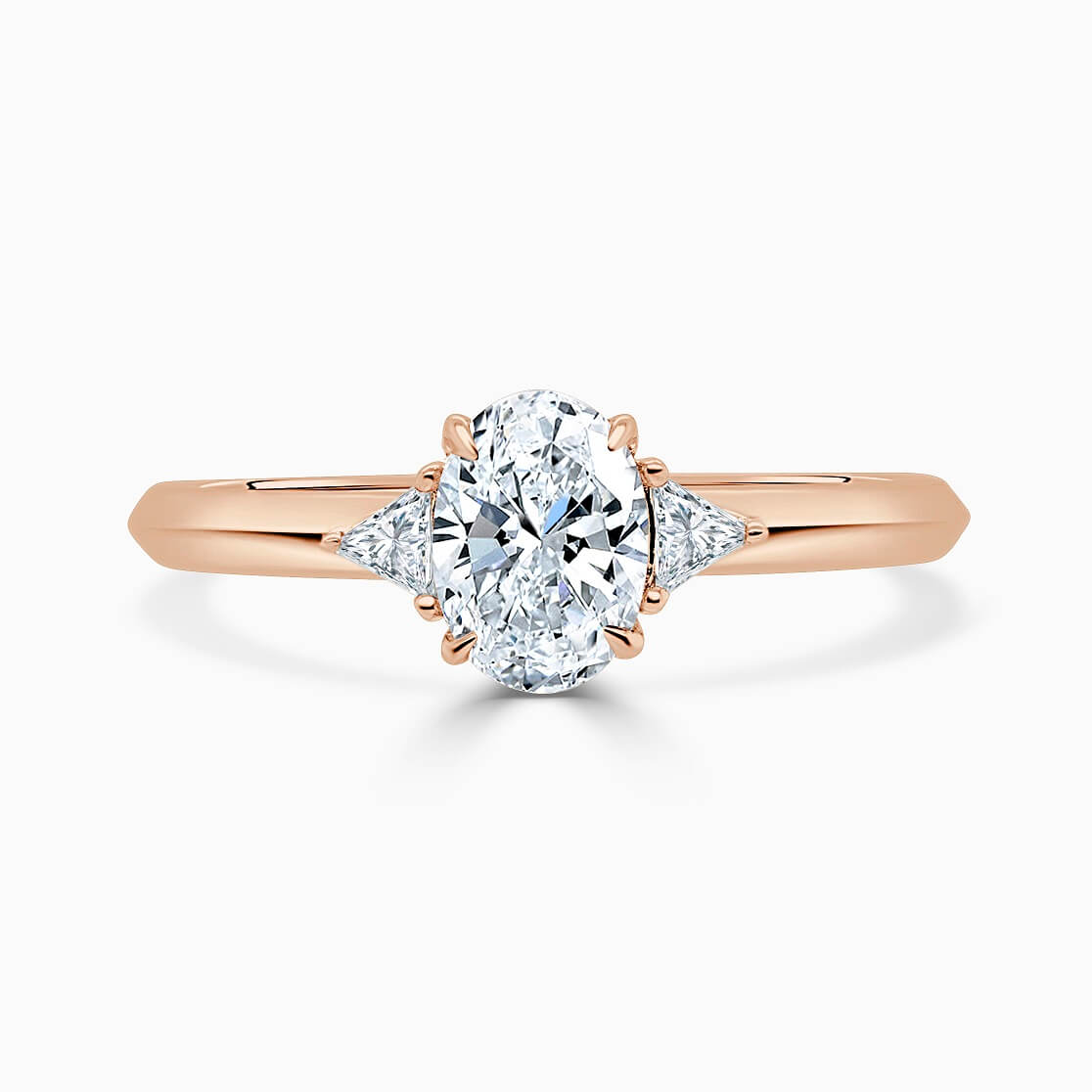 18ct Rose Gold Oval Shape 3 Stone With Trillions Engagement Ring