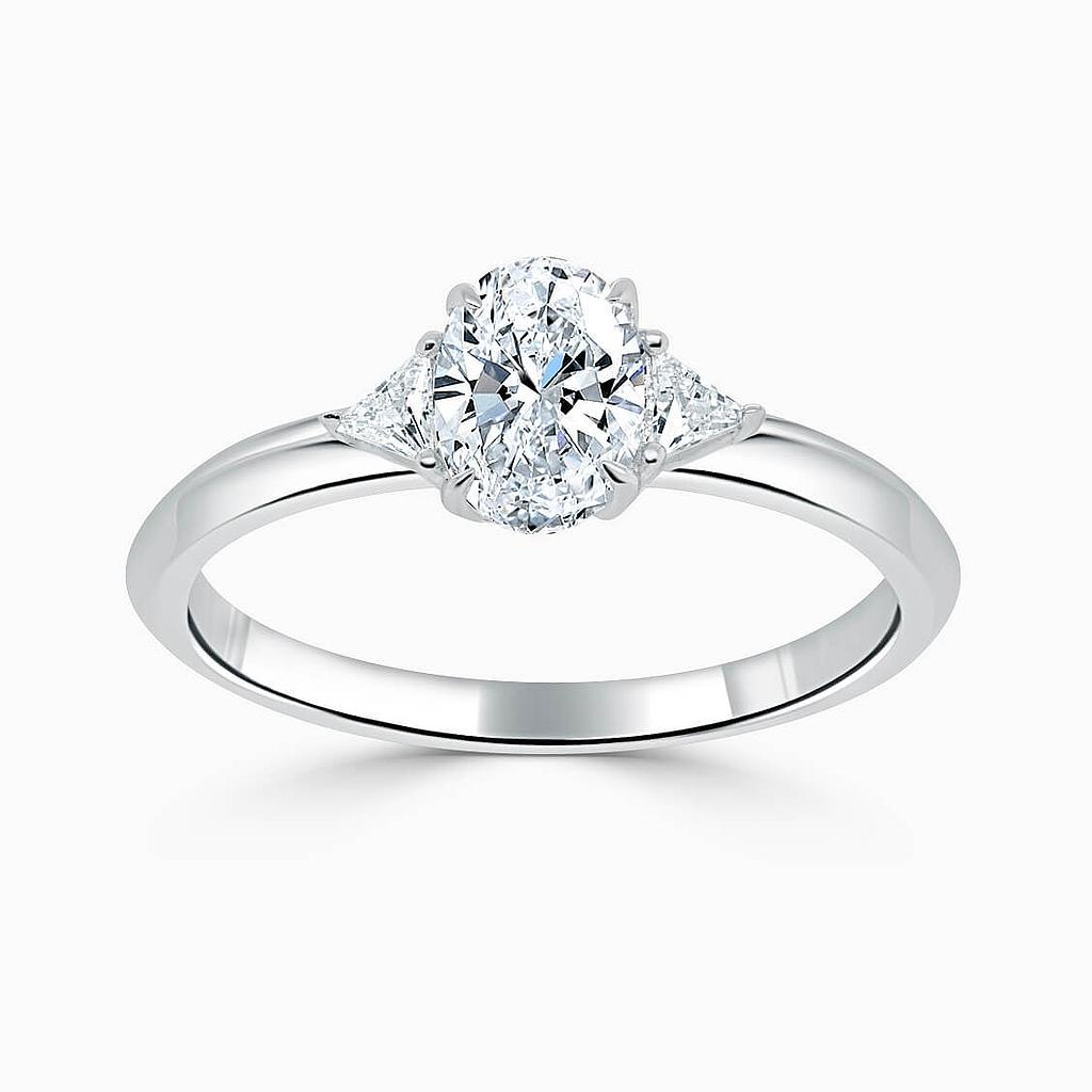 18ct White Gold Oval Shape 3 Stone With Trillions Engagement Ring