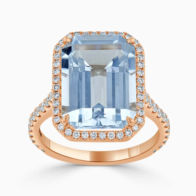 18ct Rose Gold Emerald Cut Blue Topaz & Diamond Halo Ring