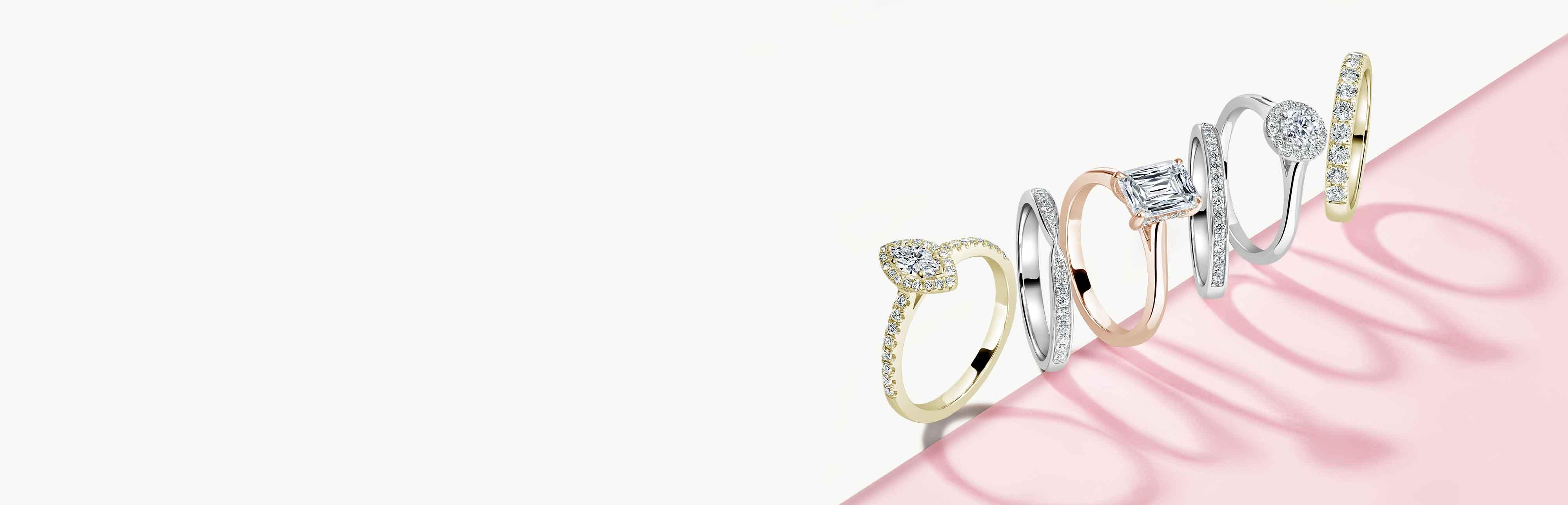 Round Brilliant Shoulder Set Engagement Rings