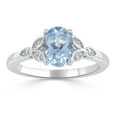 A light blue aquamarine stone set alongside diamonds.