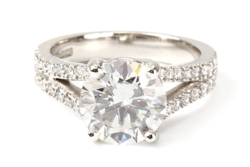 Double row shoulder set diamond engagement ring