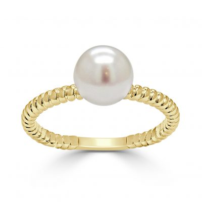 A large akoya pearl mounted on a gold ring.