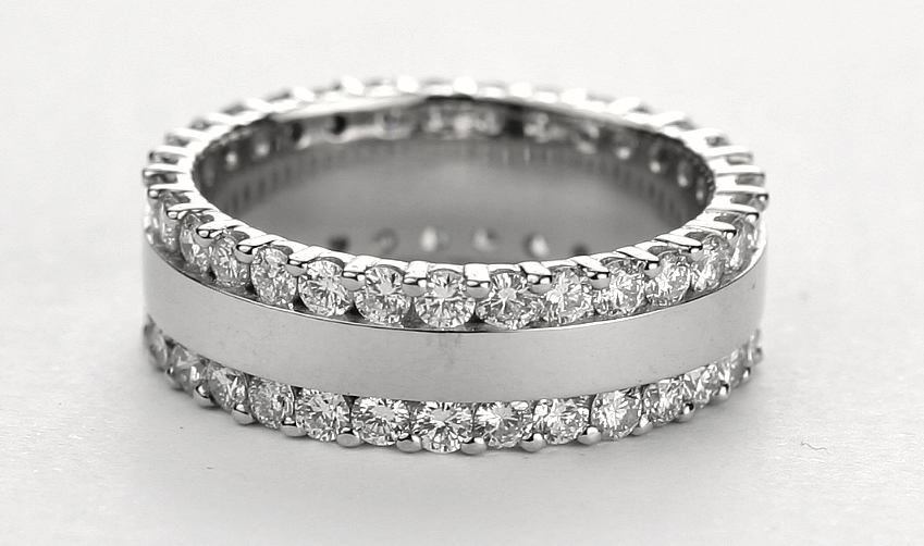 a two row diamond wedding ring with a platinum band in the middle