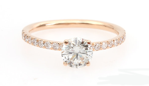Rose gold diamond engagement ring with diamond shoulders