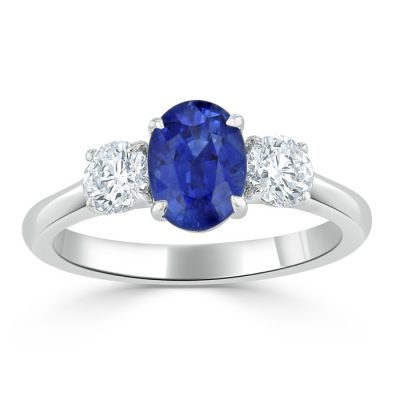 A sapphire ring with two smaller diamonds.