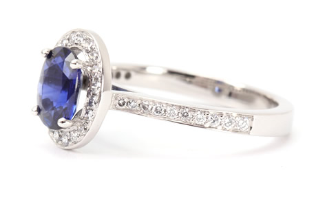 Sapphire and halo diamond ring