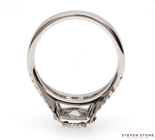 Split shoulder halo diamond engagement ring