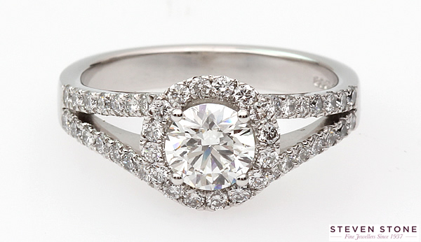 Split shoulder halo diamond engagement ring