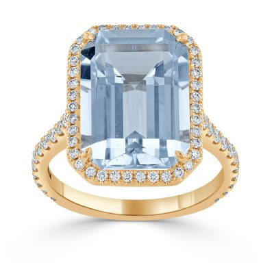 A large, emerald cut topaz stone in rose gold.