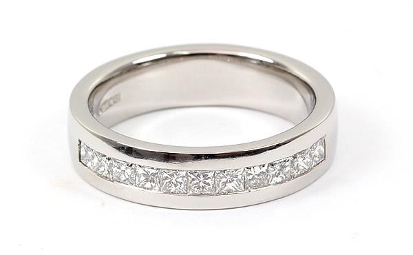channel set princess cut diamonds engagement ring