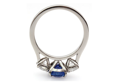 Diamond and oval shaped sapphire dress ring