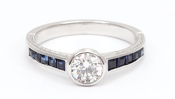 diamond and sapphire bezel engagement ring