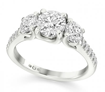 diamond shoulder set three stone ring