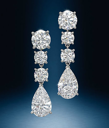 pear and round brilliant cut diamond drop earrings