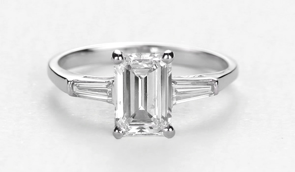 emerald diamond engagement ring with accent baguette side diamonds