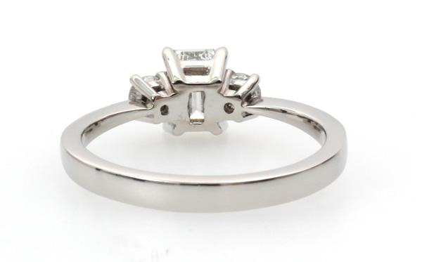 emerald cut diamond three stone engagement ring