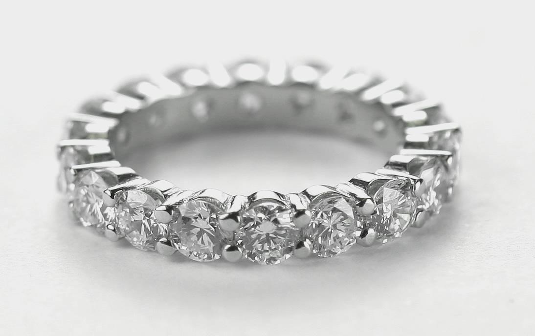 full round diamond wedding ring set in 18 carat white gold