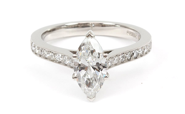 marquise diamond engagement ring with diamond set shoulders