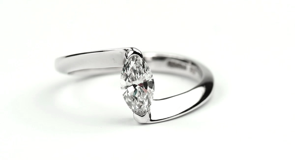 Marquise diamond engagement ring with crossover setting