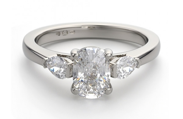 oval diamond engagement ring with three stones