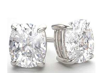oval-shaped claw set diamond earrings