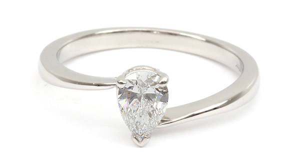 pear shaped cross over diamond engagement ring