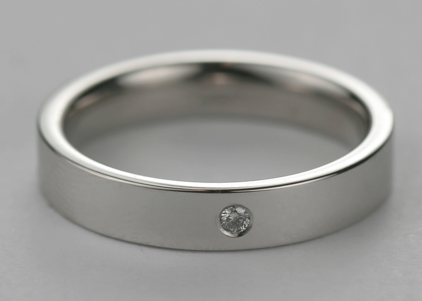 Platinum mens wedding ring with diamond set in the band of the ring