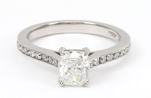 radiant cut diamond engagement ring with diamond set shoulders