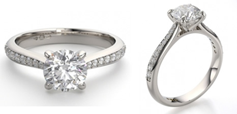 round diamond engagement ring with tapered diamond set shoulders