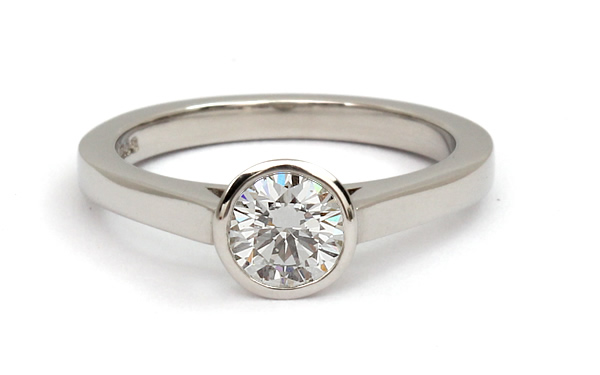 solitaire rub over set diamond engagement ring