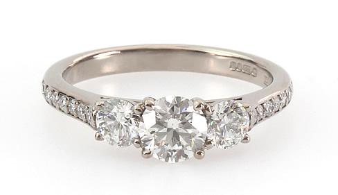 three stone diamond engagement ring with diamond set shoulders