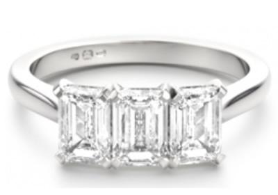 three stone emerald diamond engagement ring